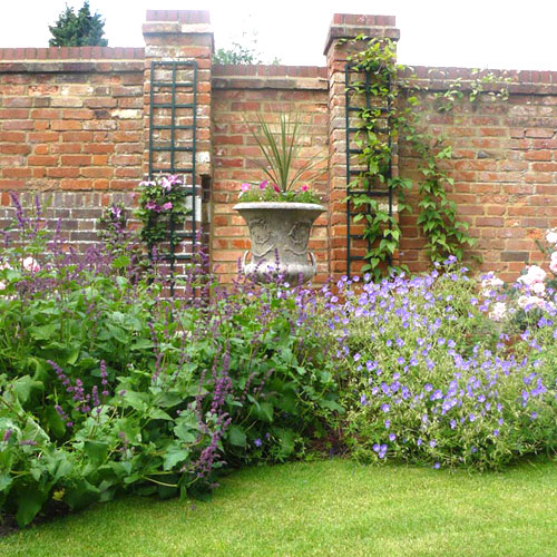 Landscaping and garden planting design for a walled garden in