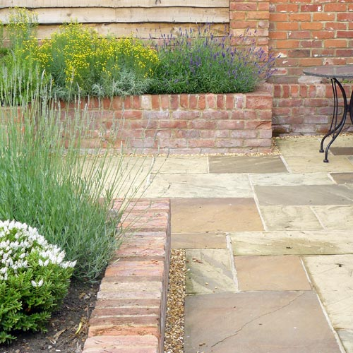 Modern Cottage Garden York stone paths and local brick walling