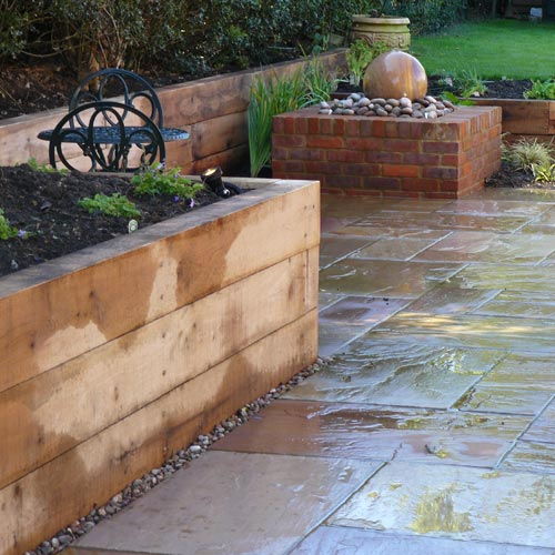 Oak Sleepers and Sandstone Paving